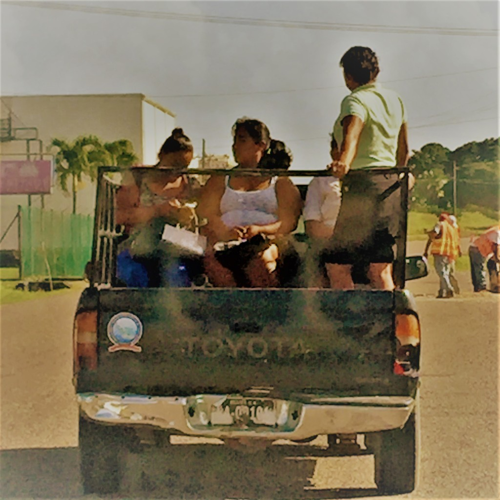 In Belize hitch hiking is mainstream and a very accepted carpooling system of sharing transportation in a country where most do not own cars