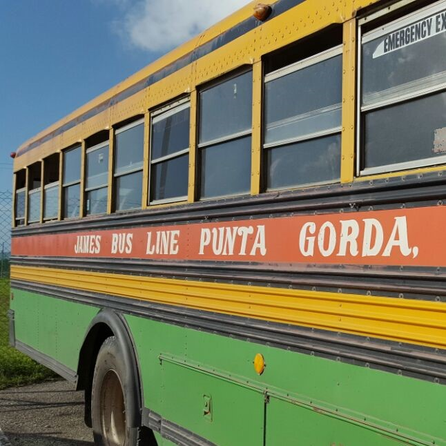 Refurbished school buses serve as public transportation in Belize